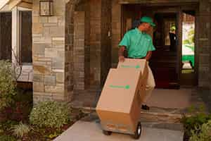 residential movers transporting belongings into home